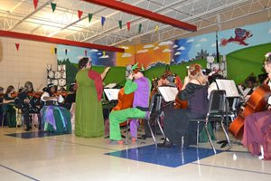E. L. Wright Orchestra performs during school Madrigal