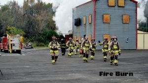 Firefighting students at a practice burn